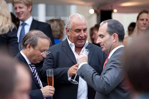 Sir Philip Green (centre) with British Land chief Chris Grigg (right) at an event in 2011