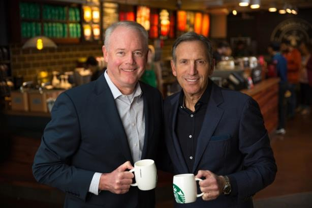 Incoming Starbucks CEO Kevin Johnson shares a coffee with his predecessor Howard Schultz