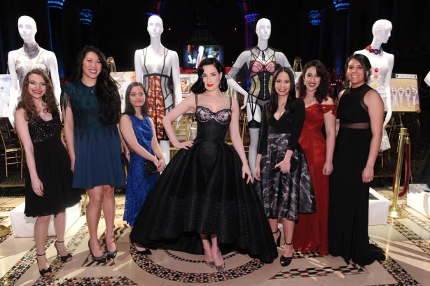 Dita Von Teese with student designers at the Femmy Awards.