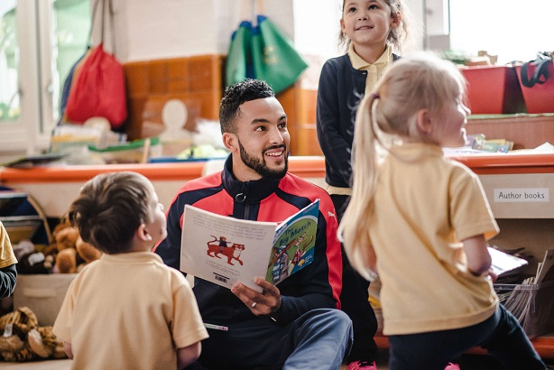 Good work off the pitch: Arsenal's Theo Walcott in the Premier League's new Primary Stars CSR campaign