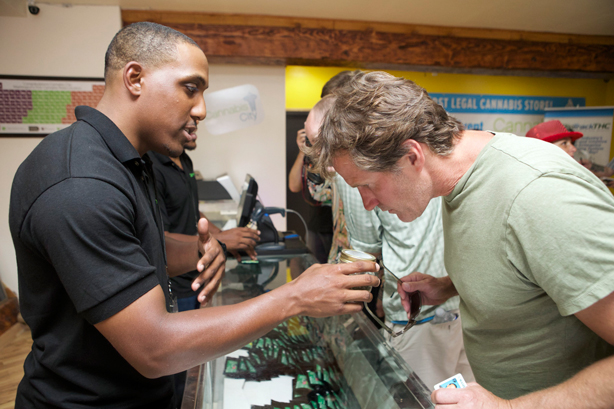 A consumer smells cannabis in a store in Seattle