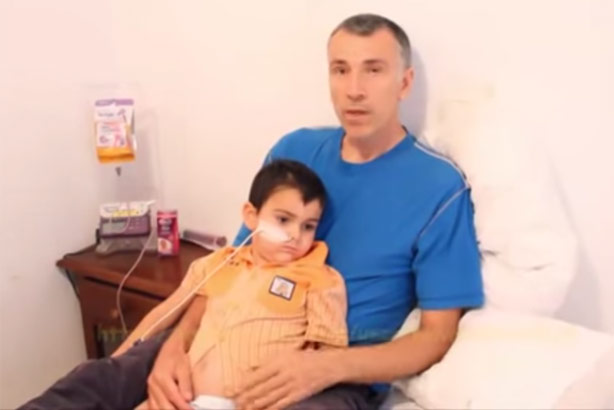 Ashya King: with his father Brett in a YouTube video made by the family