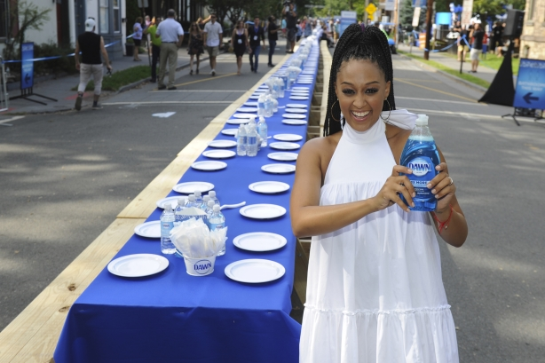 Actress Tia Mowry in front of the 2,000-foot table that seated a New Jersey town