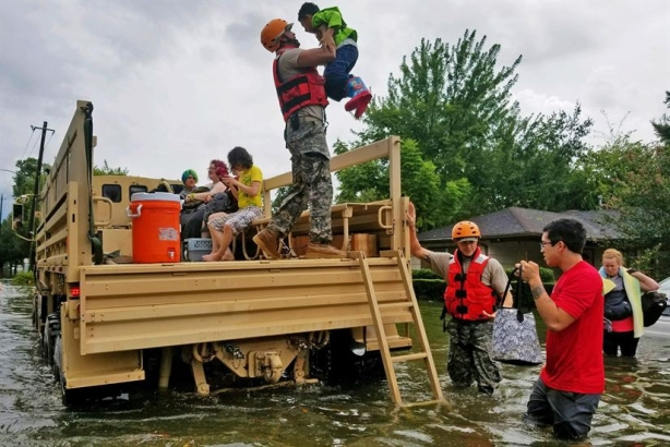 Texas National Guard soldiers assist residents affected by flooding caused by Hurricane Harvey in Houston, Aug. 27, 2017. National Guard photo by Lt. Zachary West (image via Department of Defense website)