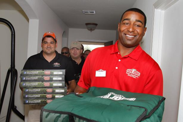 The NFL and Papa John's in happier times as Hall of Famer Chris Carter delivers a pizza (Photo credit: Getty Images)