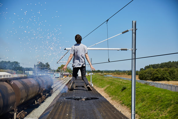 The scene from the You Vs Train film, depicting the moment Tom Hubbard is struck by 25,000 volts (Pic credit: The Progress Film Company)