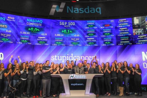 Members of Stupid Cancer ring the bell to open the Nasdaq exchange last Novembe. (Image via Stupid Cancer's Facebook page).