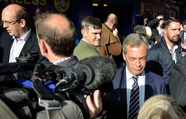Gawain Towler (in green) with Farage in 2014 (© PjrNews/Alamy Stock Photo)