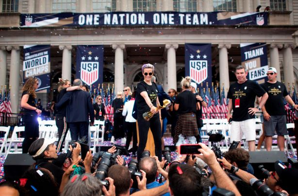 USWNT captain Megan Rapinoe takes the plaudits at NYC ticker-tape parade (Getty Images).