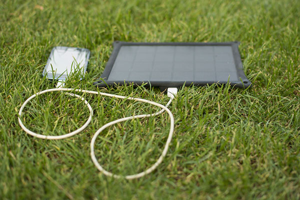 Products: Mobile phone with solar powered charger (photograph: Adam Radosavljevic/123RF)