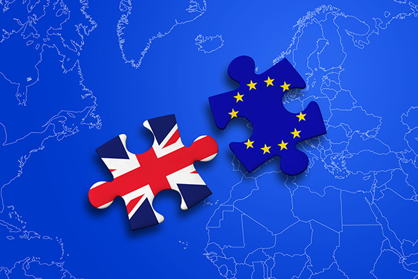 Brexit illustration: one jigsaw piece with EU flag and one with Union Jack. Photograph: Alessandro Bianco/123RF
