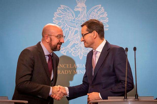 President-elect of European Council Charles Michel (left) and Polish prime minister Mateusz Morawiecki (Photo by WOJTEK RADWANSKI/AFP via Getty Images)