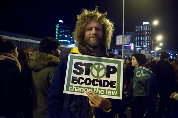 A protester holds a placard during a demonstration in Madrid, Spain, last year (Photo by Lito Lizana/SOPA Images/LightRocket via Getty Images)