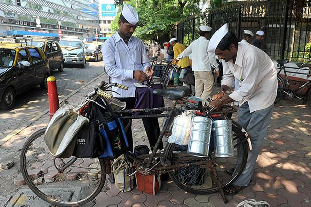 Mumbai: home to a sophisticated system to deliver lunch in stainless steel tiffin boxes to office workers. Photo: Indranil Mukherjee/AFP via Getty Images
