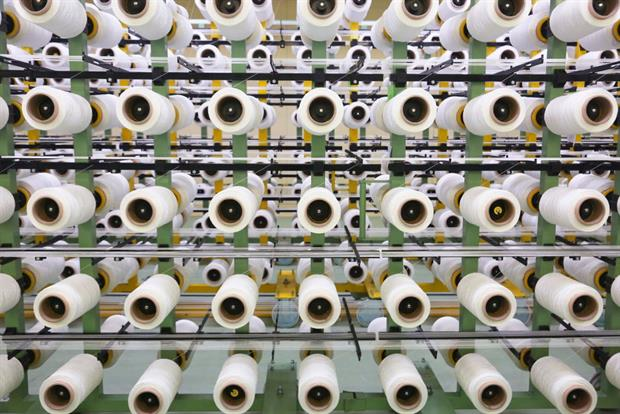 Spools of polyester thread at a Texxcore factory in Volzhsky, Russia. Synthetic fibres are a major source of microplastic pollution, posing a serious challenge to regulators. Photo: Dmitry Rogulin/TASS via Getty Images