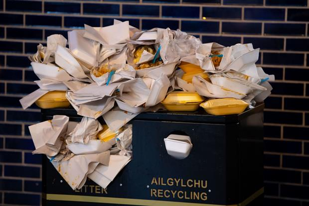 A bin overflowing with food containers, December 2018 in Cardiff, UK. New evidence suggests widespread use of PFAS in paper packaging. Photo: Matthew Horwood via Getty