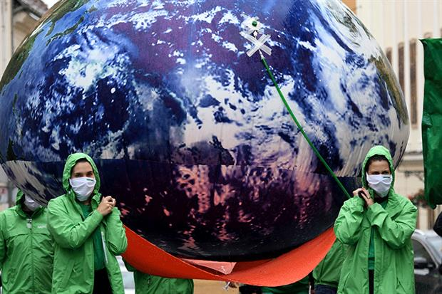 Croatian climate activists carried an inflatable earth through the streets of Zagreb earlier this month. Photograph: Denis Lovrovic/Getty Images