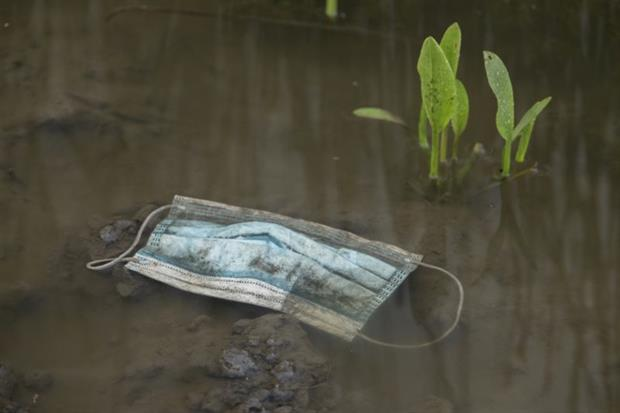 Covid-19: A medical face mask floats in a puddle in the Odessa region of Ukraine. The pandemic has led to a spike in plastic pollution worldwide. Photograph: Andrey Nekrasov/Barcroft Media via Getty Images