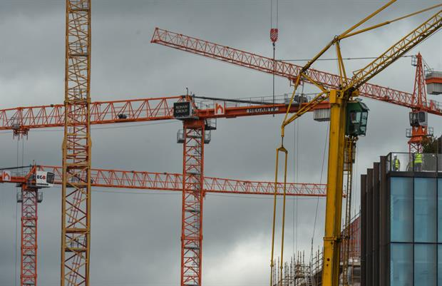 Cranes in Dublin's Docklands, June 2021. Campaigners are urging the European Commission not to abandon its pledge for a holistic approach to the built environment. Photo: Artur Widak/NurPhoto via Getty Images