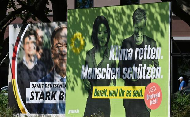 Green and CDU election posters in Germany: while support for the Greens surged earlier this year, the party has since returned to third place in the polls. Photo: John MacDougall/ AFP