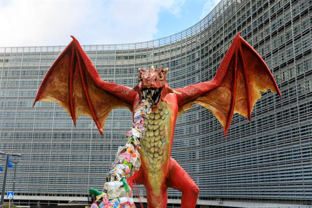 A dragon spews plastic outside the European Commission headquarters in Brussels on Thursday. The EU executive has promised to crack down on plastic waste exports. Photo: Thierry Monasse/Getty Images