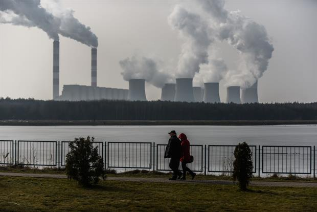 A couple walks past Poland's Belchatow power station, the world's largest lignite-fired plant. Campaigners have said member states are not ambitious enough in their approach to new emissions rules. Photo: Omar Marques/Getty Images