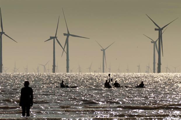 The Burbo Bank offshore wind farm seen from the banks of the Mersey, in the UK, August 2021. Prime minister Boris Johnson is set to announce a 100% clean power target by 2035. Photo: Christopher Furlong/Getty Images