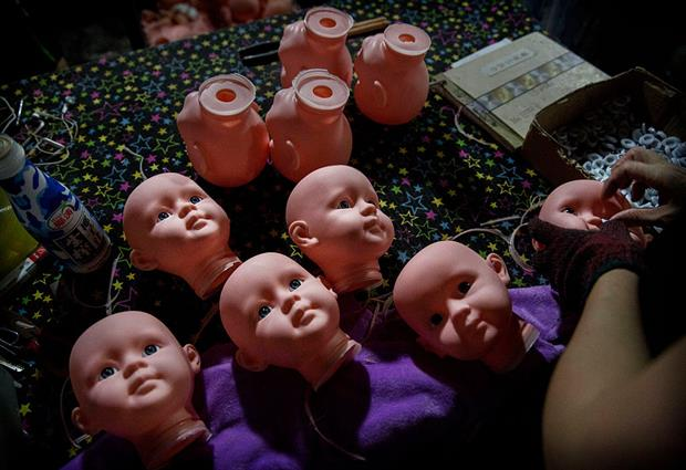 Plastic dolls being assembled. Cefic has warned that banned chemical DEHP frequently shows up in dolls imported from China. Photo: Kevin Frayer/Getty Images