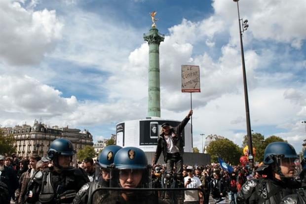 The fight begins: A protestor at the Place de la Bastille in Paris, the traditional starting point of the city's May Day marches, 2017. Photo: Salvador Banyo/NurPhoto via Getty Images