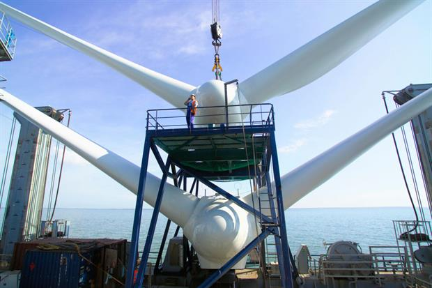 Wind turbines under construction near Whistable, UK. The European Commission aims to boost private sector investment in sustainable energy. Photo: Chris Laurens/Construction Photography/Avalon/Getty Images