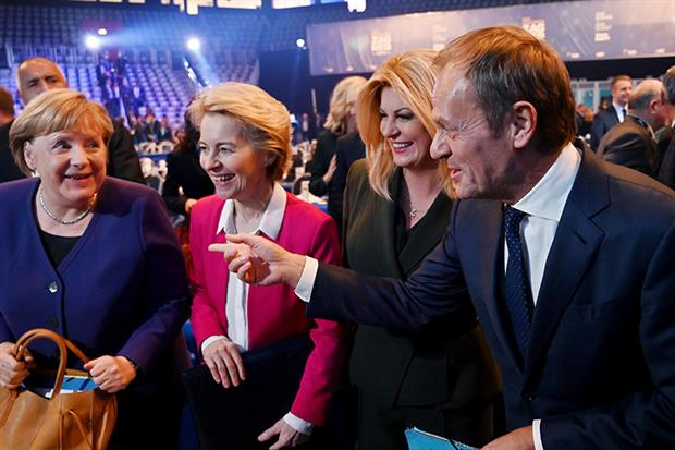 New European People's Party President Donald Tusk laughs with German chancellor Angela Merkel, Commission president-elect Ursula von der Leyen and Croatian President Kolinda Grabar Kitarovic (Photo by DENIS LOVROVIC/AFP via Getty Images)