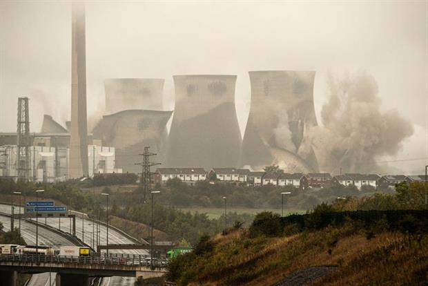 Coal collapse: four cooling towers at the UK's Ferrybridge plant were demolished in October 2019 (Photo by OLI SCARFF/AFP via Getty Images)