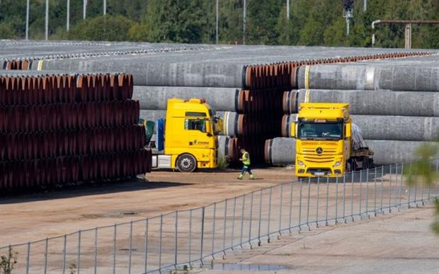"""Gas pipes bound for the Nord Stream 2 fossil gas pipeline: Green industry is worried that the ECT gives fossil fuel investors recourse to """"obscure private arbitration procedures"""". Photo: Odd Andersen/AFP via Getty Images"""