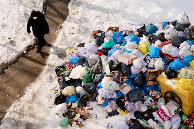 A man walks past accumulated rubbish in the streets of Madrid due to the snow caused by storm Filomena on January. Photo: Mariano Regidor/Getty Images