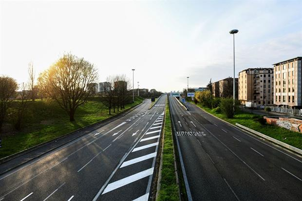 Covid-19: The Viale Alcide de Gasperi, usually one of the busiest roads of Milan is empty during coronavirus lockdown (Photo by PIERO CRUCIATTI/AFP via Getty Images)