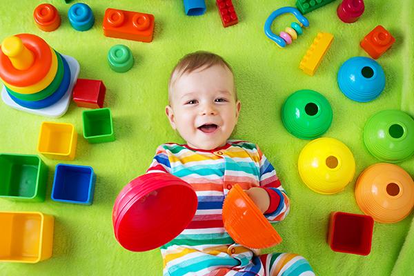 Plastics: child playing with plastic toys on rug. Photograph: Anna Grigorjeva/123RF