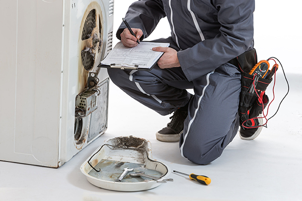 Sustainability, washing machine being repaired (Photograph: Jean-Paul Chassenet/123RF)