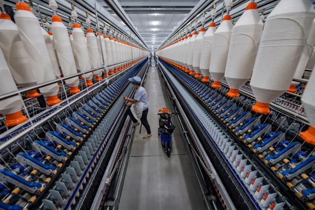 An employee works at a textile factory in Baoji, Shaanxi Province of China, December 2020. Textiles sold in the EU have a major global footprint. Photo: Yuan Jingzhi/VCG via Getty Images