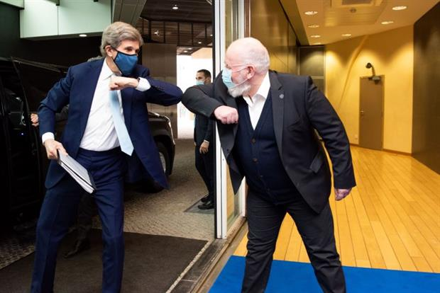 John Kerry and Frans Timmermans share a now-customary elbow bump following talks on climate policy this week. Photo: Jennifer Jacquemart / European Commission