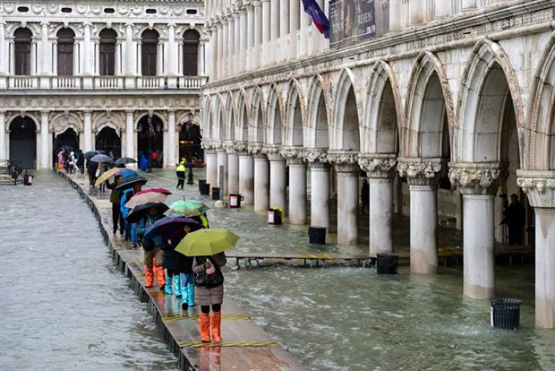 Climate change: thousands of Venetians have taken to the streets to protest over frequent flooding (Photo by MIGUEL MEDINA/AFP via Getty Images)