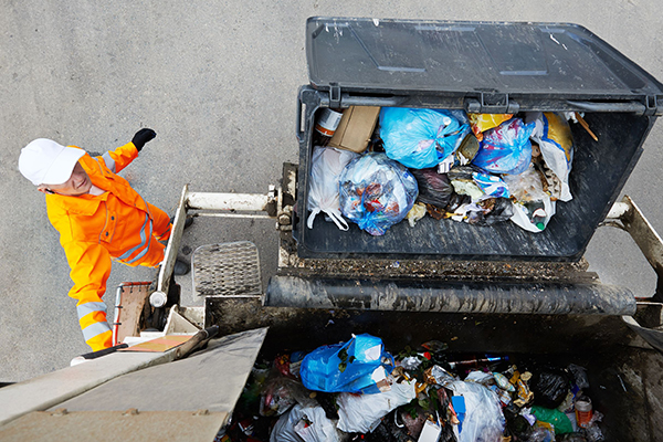 Waste: Municipal worker loads refuse vehicle (photograph: Dmitry Kalinovsky/123RF)
