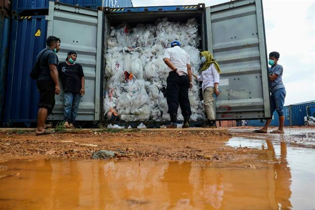 Indonesian officials check one of the 49 containers illegally loaded with garbage, plastic waste and hazardous materials from France and other developed countries, June 2019 on Batam island. Photo: Andaru/AFP via Getty Images