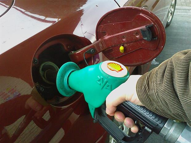 """""""Filling up with unleaded fuel"""" by freefotouk is licensed under CC BY-NC 2.0"""