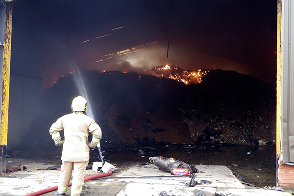 The material brought onto the site caught fire at least twice in the summer of 2014. Photograph: Natural Resources Wales