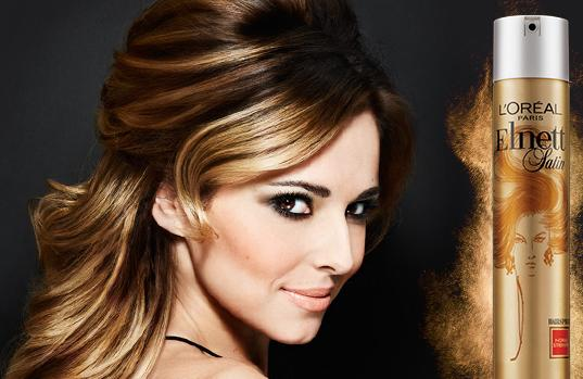 Singer Cheryl Fernandez-Versini advertises L'Oréal hair products range