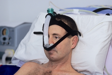 Patient with motor neurone disease on a ventilator (Photograph: SPL)
