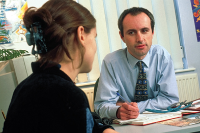 It is essential for the GP's approach to be non-judgmental when discussing termination of an unwanted pregnancy with a young couple (Photograph: SPL)
