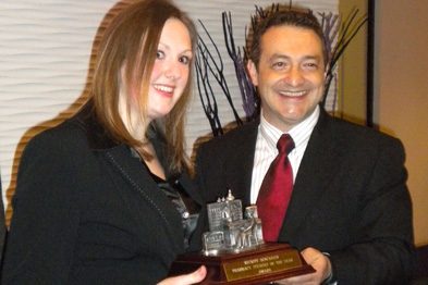 Rosaline Kennedy receiving her trophy