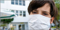 Patient with face mask (Photograph: iStockPhoto)