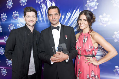 Dr Hickman (centre) was presented with his award by Danny O'Donoghue and Amanda Byram